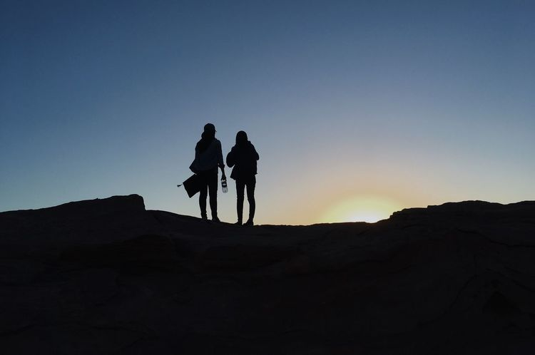 Petra Jordan Silhouette Friendship Sunset EyeEmNewHere Petra, Jordan Leisure Activity Petra Jordan Nature Lifestyles Sky Outdoors Desert Clear Sky Beauty In Nature Silhouette Two People Women Bonding EyeEmNewHere EyeEm Selects EyeEm Selects EyeEmNewHere Connected By Travel Lost In The Landscape