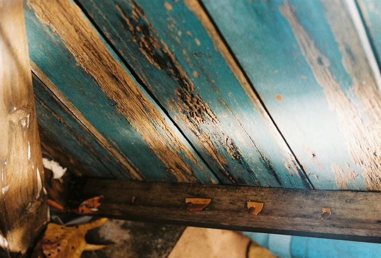 High angle view of old wooden bench
