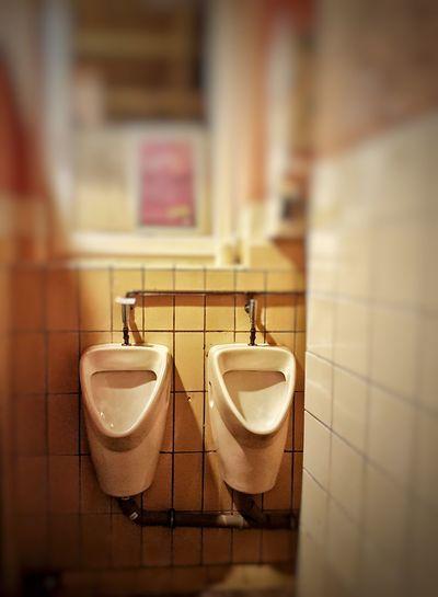 Indoors  Bathroom Urinal Public Restroom Hygiene Public Building Domestic Bathroom No People Convenience Tile Day Close-up Men Toilet Hanging Flushing Toilet Indoors  Urinal