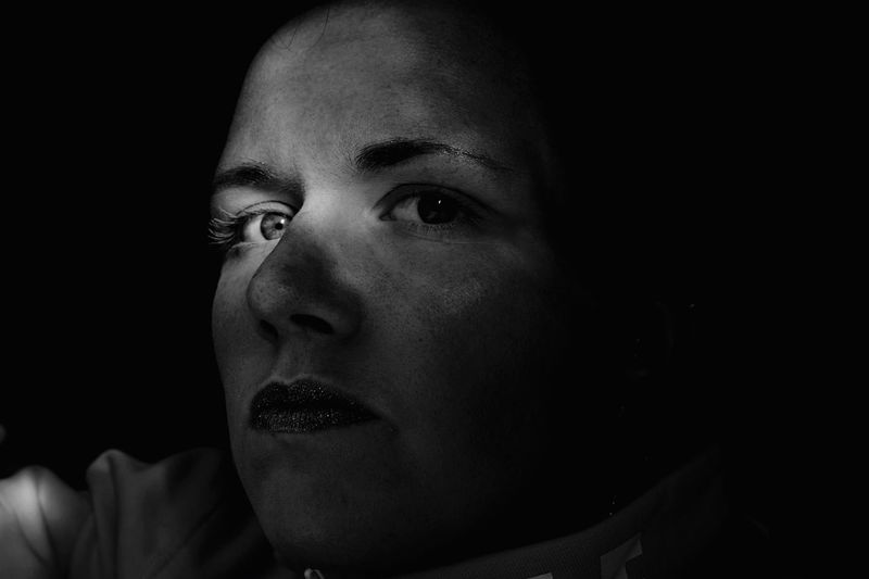Close-up portrait of mid adult man in darkroom