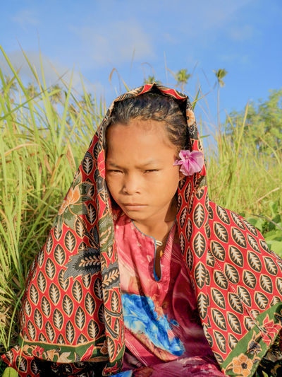 Sea Gypsy Nomadic Ethnic Maiga Island Island Semporna Sabah Malaysia People Sadness Happiness Uneducated One Person Real People Leisure Activity Lifestyles Grass Plant Front View Child Field Women Childhood Land Girls Portrait Nature Females Waist Up Casual Clothing Innocence Outdoors Hairstyle