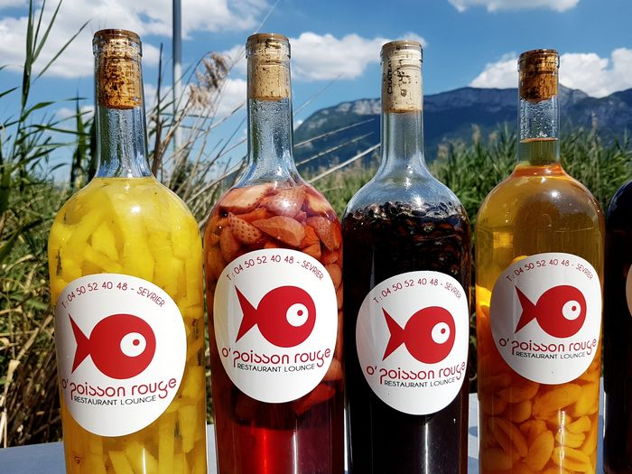Do not believe the label: no fish inside, just fruits 😉 Rum Bottles Of Alcoholic Drinks Fruits In Drink Lake View Advertising Signs Drink Alcohol Bottle Variation Text Close-up Sky