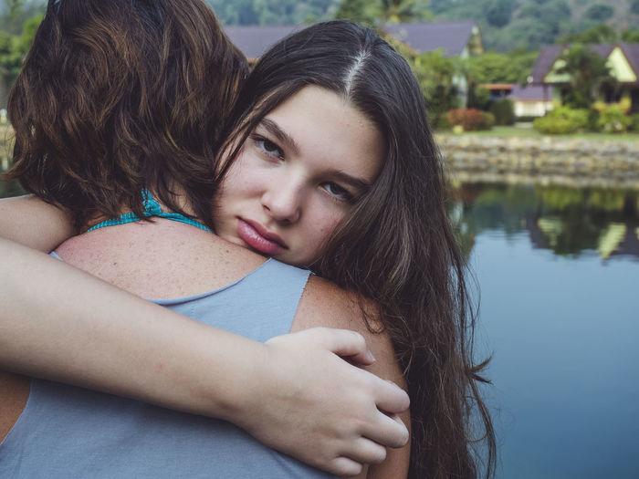 Hugging Portrait Young Adult Young Women Women Water Adult Two People Leisure Activity Hair Headshot Real People Togetherness Lifestyles Hairstyle Positive Emotion Couple - Relationship