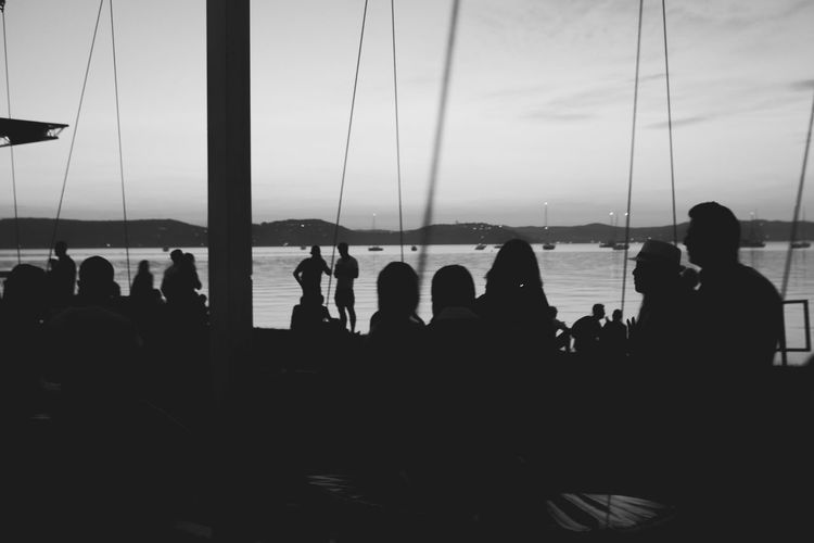 Festival season Beach Black And White Evening Festival Lake Large Group Of People Party Silhouette