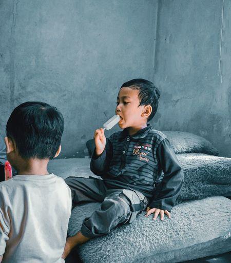 Boys sitting on wall