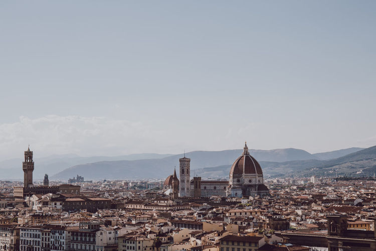 View of florence cityscape against sky, on a summer day, italy.