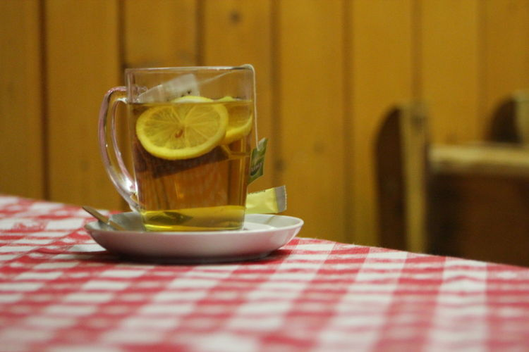-8. Fruit tea with a slice of lemon. Delicious. Close-up Day Drink Drinking Glass Food And Drink Freshness Healthy Eating Indoors  Lemon No People Refreshment Serving Size SLICE Still Life Table -8℃ No Edit/no Filter Delicious The Purist (no Edit, No Filter)