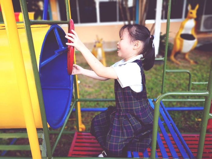 Side view of girl playing in playground