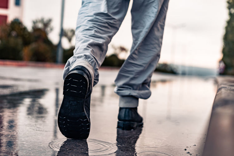to no-where Low Section Shoe Body Part Human Body Part Human Leg One Person Focus On Foreground Water Reflection Jeans Wet Casual Clothing Day Human Limb Limb Lifestyles Pants Nature Outdoors Rain Human Foot