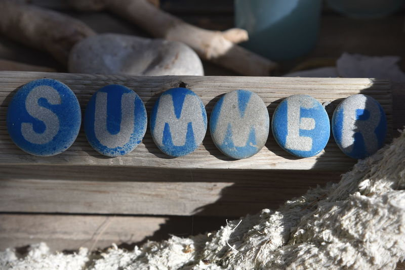 Beach Life Cyprus Blue Close-up Communication Day No People Outdoors Schild Shadow Stack Steine Summer Sunlight Text Wood - Material Zypern