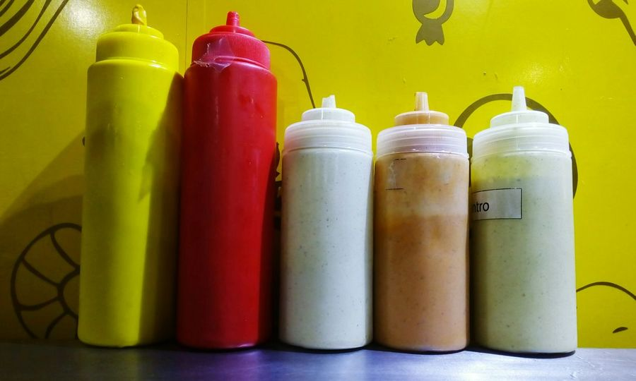 Bottles with diferent kind of sauces at a food truck Bottle Plastic Bottles Food Food And Drink Catsup Mustard Sauce Multi Colored Yellow Variation Close-up Served Ketchup Ready-to-eat