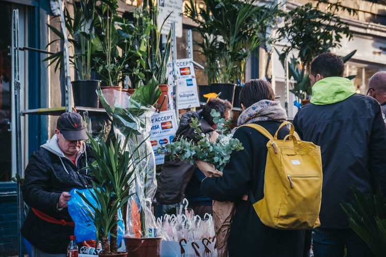 People buying plants and flowers at the Columbia Road Flower Market, a street market in East London that is open every Sunday. London Uk East London City City Life Weekend Activities Winter Day Columbia Road Flower Market Flowers Market Street Market Leisure Activity Recreational Pursuit Flowers Plants Shopping London lifestyle Real People Incidental People