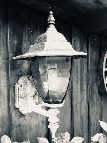 No People Lighting Equipment Day Wall - Building Feature Close-up Architecture Built Structure Metal Hanging Outdoors Wood - Material Building Bell Old Shape Building Exterior Street Light Electricity  Wall