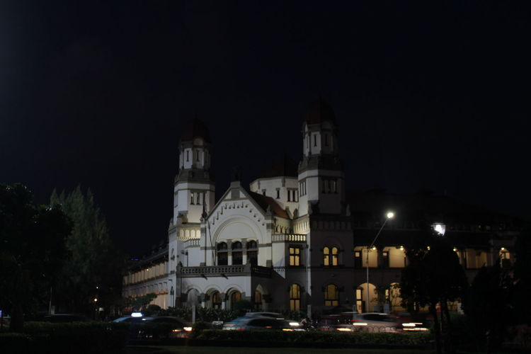 Illuminated cathedral against sky at night