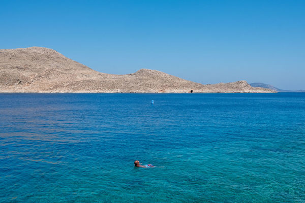 Mostly blue - Aegean, Greece 2018 Aegean Halki Beauty In Nature Blue Clear Sky Copy Space Day Greece Island Land Leisure Activity Lifestyles Mountain Nature One Person Outdoors Real People Scenics - Nature Sea Selective Focus Sky Tranquil Scene Tranquility Turquoise Turquoise Colored Water Waterfront