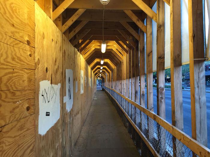 Illuminated Empty Corridor Of Building