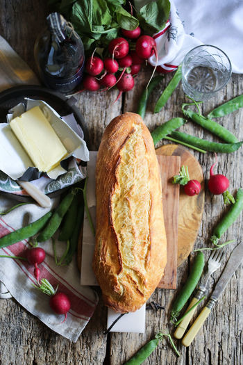 Food And Drink Food Healthy Eating Vegetable Freshness Wellbeing Bread Table Dairy Product Wood - Material Cutting Board Still Life No People High Angle View Table Knife Preparation  Radishes Butterfly - Insect Fresh Peas Peas