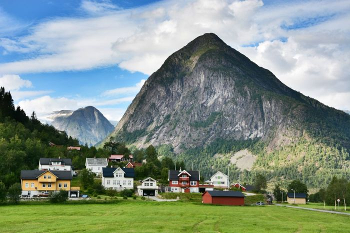 Rural Landscape Travelling Travel Photography Scenery Summertime Peaceful View Wanderlust Travel Norway Mountains Mountain Architecture Built Structure Cloud - Sky Building Exterior Sky Land Mountain Range Nature Beauty In Nature Landscape Day Scenics - Nature Residential District