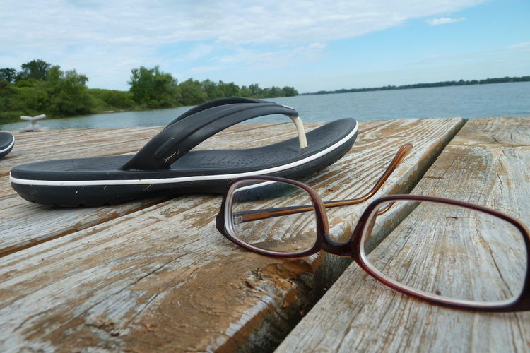 Composition Flipflop Glasses Part Of Peaceful Reading Time Sittingonthedock Solitude Water