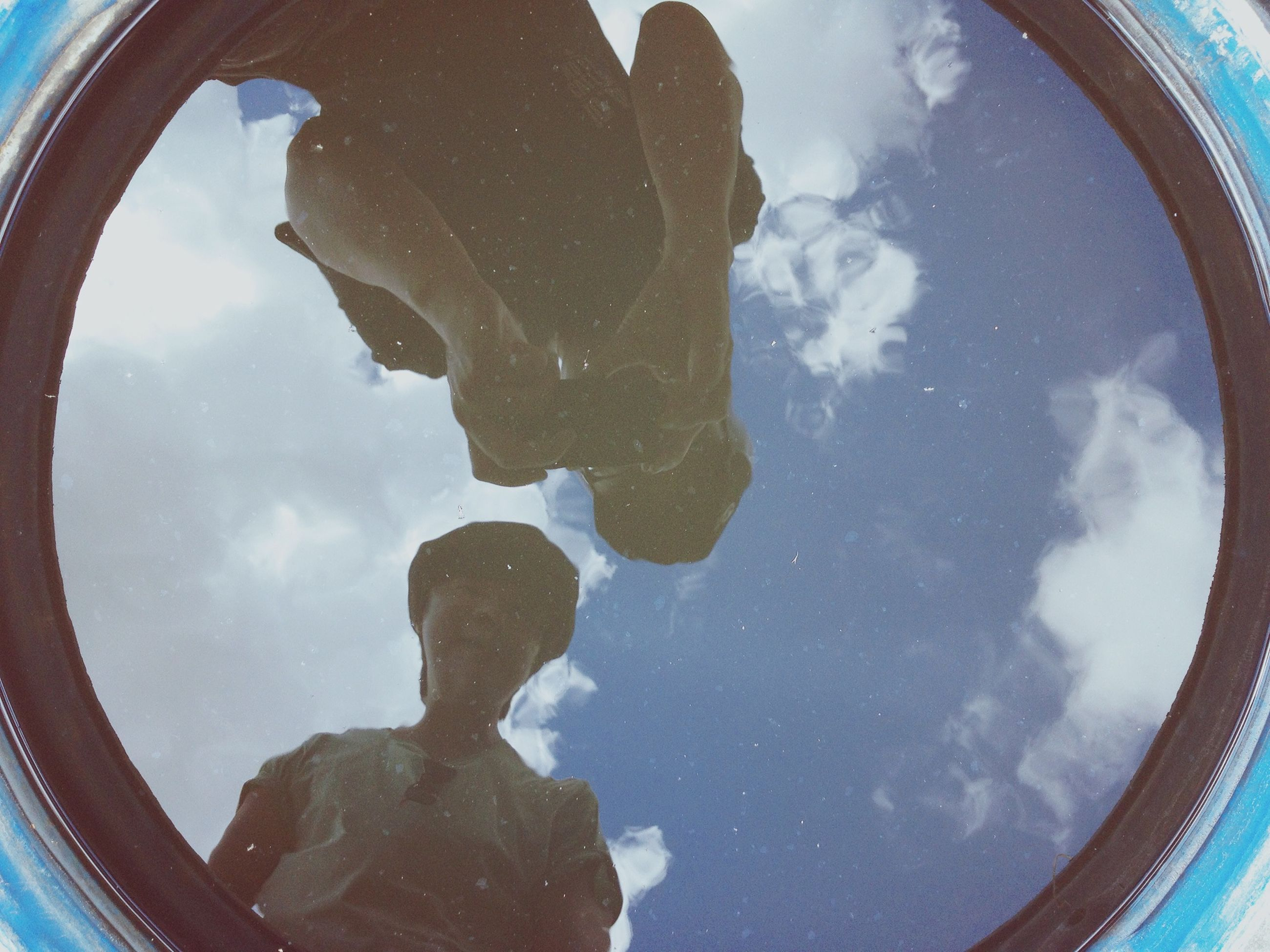sky, cloud - sky, low angle view, cloud, fish-eye lens, cloudy, circle, blue, day, no people, transportation, nature, geometric shape, outdoors, part of, sunlight, shape, built structure, metal, arch