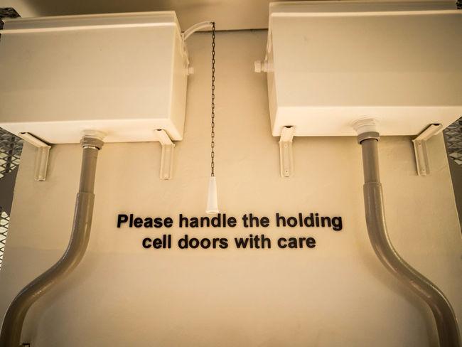 Indoors  No People Nostalgia Text Toilet Toilet Flush