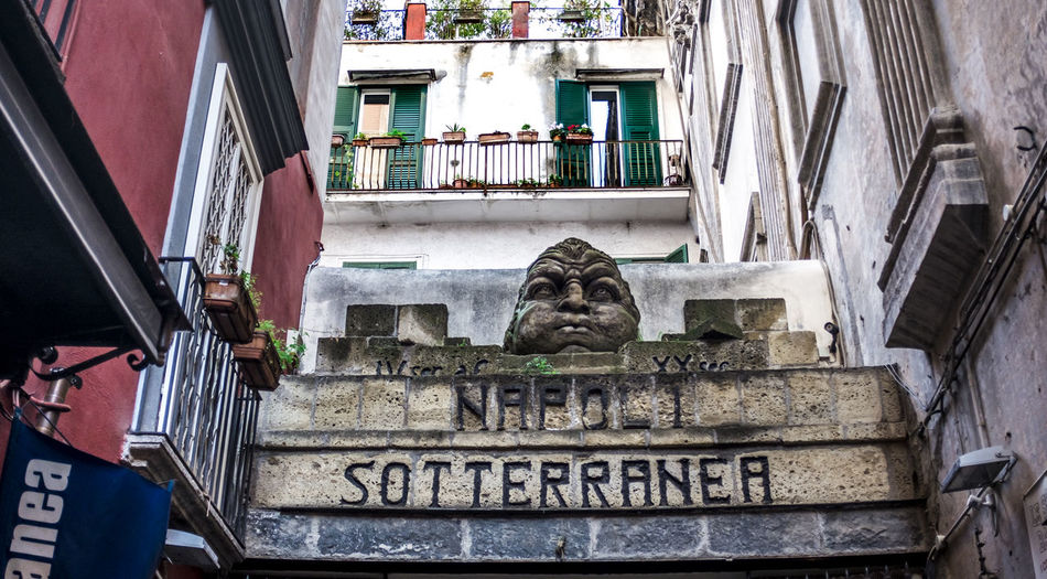 entrance to the Naples underground , the tourist destination of old aqueduct and cisterns on city Napoli Napoli Sotterranea Entrance Antique Underground Travel Tourism Aqueduct Old Cave Center Galleries Tunnels Town Cavern Italy Catacomb Landmarks