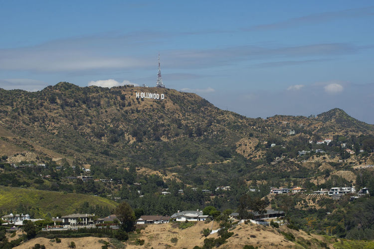 View of Hollywood sign, the famous landmark of Los Angeles for its film industry Architecture Sky Hill Movie Industry 45 Ft Letters Capital Letters Santa Monica Mountains Fortune Television Cultural Icon White Letters Restored Antenna Hollywoodland Famous Sign Outdoor TV Tower Cloudy Sky Landscape Tower Outdoors USA MOVIE Cinema City Los Advertisement Industry Hollywood Hills View Ángeles Hills Los Ángeles Symbol Entertainment Destination Icon Tourism Famous Film Travel Hollywood Sign California Landmark