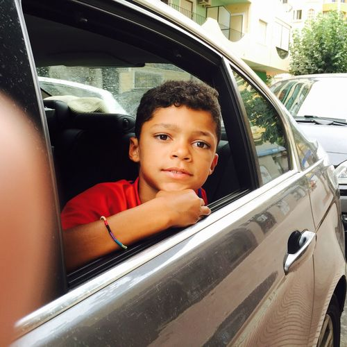 Portrait of boy sitting in car