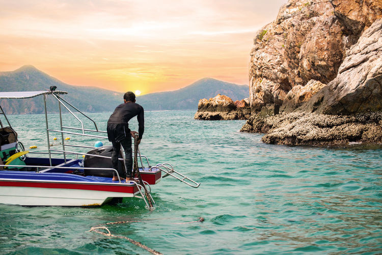 Nautical Vessel Transportation Real People Sea Mode Of Transportation Sky Beauty In Nature Water One Person Scenics - Nature Men Lifestyles Nature Standing Sunset Waterfront Mountain Rock - Object Rock Outdoors Archor Scuba Diving Snokeling Beach Island Sun