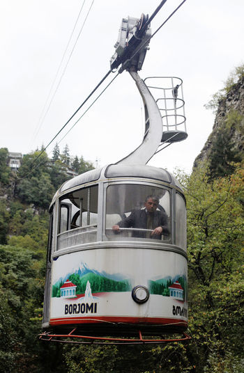 Bordschomi Georgia Journey Sign Land Vehicle Outdoors Text Men Real People Group Of People Travel Cable Car Cable Communication Public Transportation Tree Plant Sky Nature Day Mode Of Transportation Transportation
