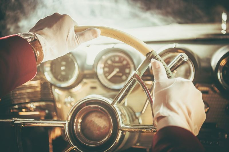 Cropped Hands Driving Vintage Car