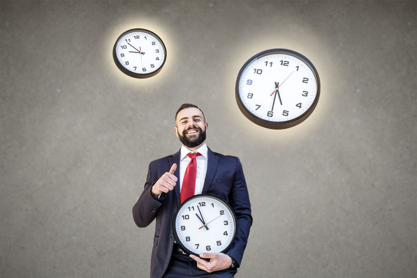 Model: Roberto Materiale Adult Business Business Person Businessman Checking The Time Clock Clock Face Clock Hand Deadline Front View Hour Hand Indoors  Instrument Of Time Males  Men Minute Hand Office One Person Standing Time Urgency Wall Clock Well-dressed
