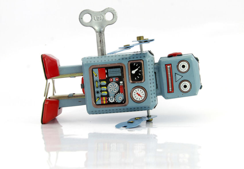 retro robot toy is done Copy Space Fed Cup Isolated Reflection Unhappy Blue Close-up Conceptual Lying Down Over Worked Reflections Robot Sad Stresed Tin Toys Tired Toy Wind Up Robot