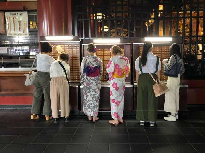 Getting the fortunes. Or maybe curses? Budhism Kimono Traditional Clothing Group Of People Full Length Rear View Architecture Women Real People Building Exterior Religion Medium Group Of People Place Of Worship