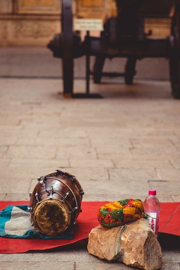 Rajasthani Table No People Religion Arts Culture And Entertainment Belief Celebration Music Personal Accessory Wood - Material Focus On Foreground Sunlight Musical Instrument Still Life Indoors  Day Carpet - Decor Spirituality Architecture Ornate
