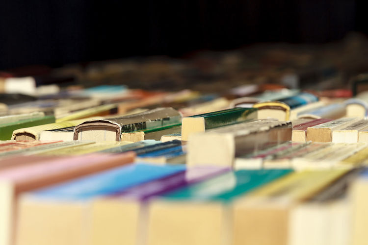 Close-up of books for sale at market