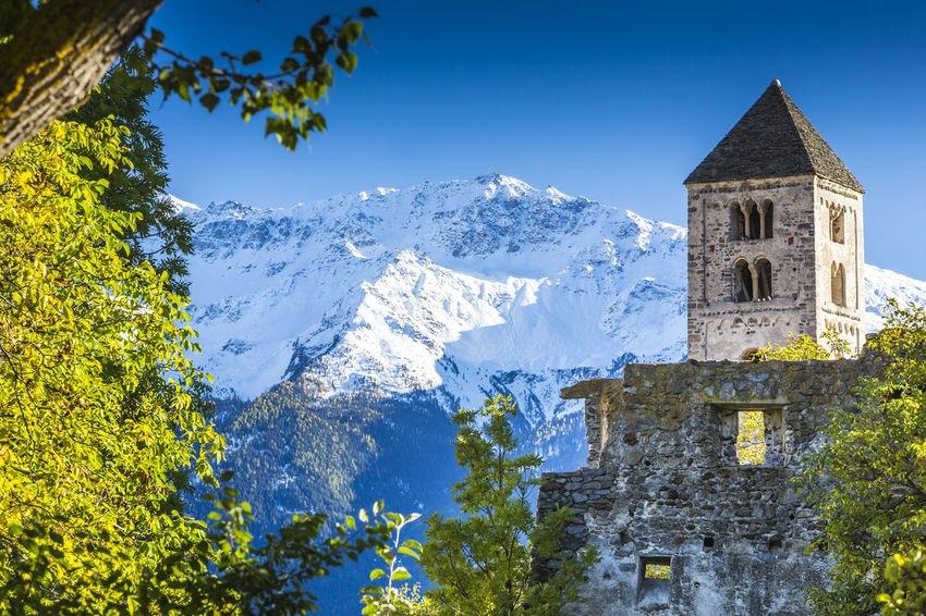 Italy, South Tyrol, Vinschgau, Mals, view to romanic church Ancient Burgeis Church Meran Ortler Reschensee Sightseeing Südtirol Alps Architecture Italy Mals Merano Nature Outdoors Place Of Worship Prad Religion Romanic Snow South Tyrol Spring Springtime Tower Tree
