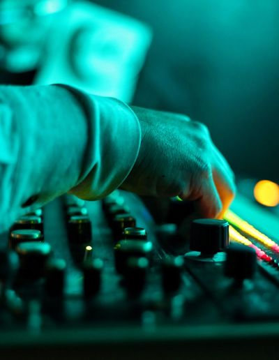 Cropped Hand Of Dj Playing Music