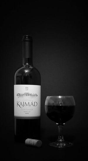 Close-up of wine bottle against black background