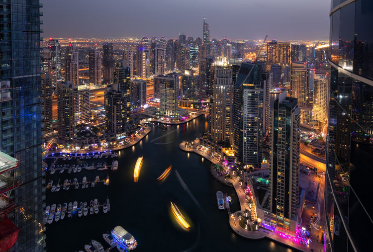 Beautiful view of the Dubai Marina at night Building Exterior Architecture Built Structure Illuminated City Cityscape Night Building Office Building Exterior Skyscraper Water Sky Modern High Angle View Urban Skyline Nature Crowd City Life Tall - High Financial District  Outdoors Dubai Dubai Marina UAE Travel