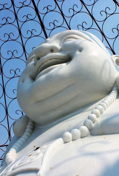 Joy discovered at a Buddhist retreat Buddhism Close-up Laughing Low Angle View No People Retreat Spirituality Statue Worship
