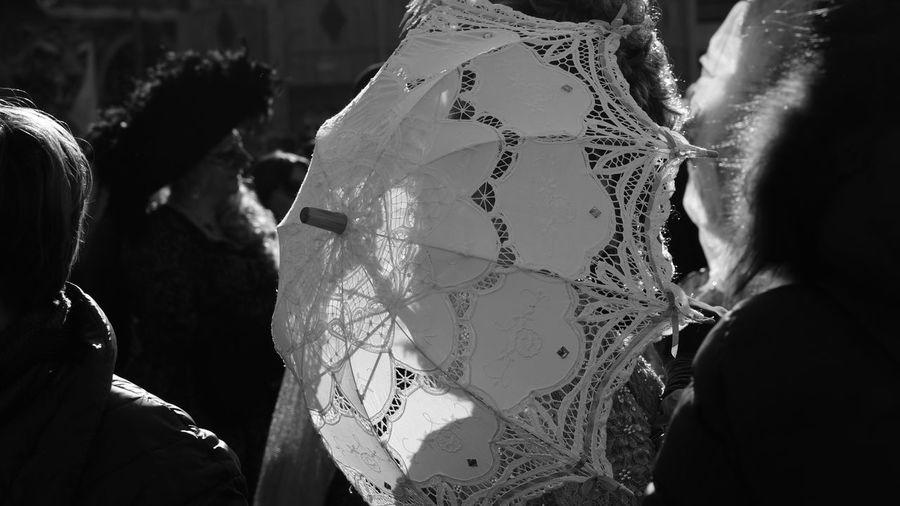 Umbrella amidst people in city