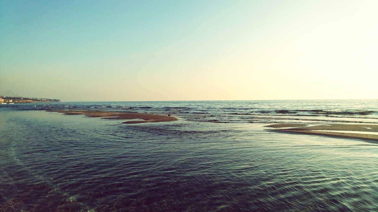 sea, water, scenics, nature, beauty in nature, beach, tranquility, tranquil scene, horizon over water, outdoors, copy space, clear sky, no people, sand, rippled, wave, waterfront, sunset, sky, day