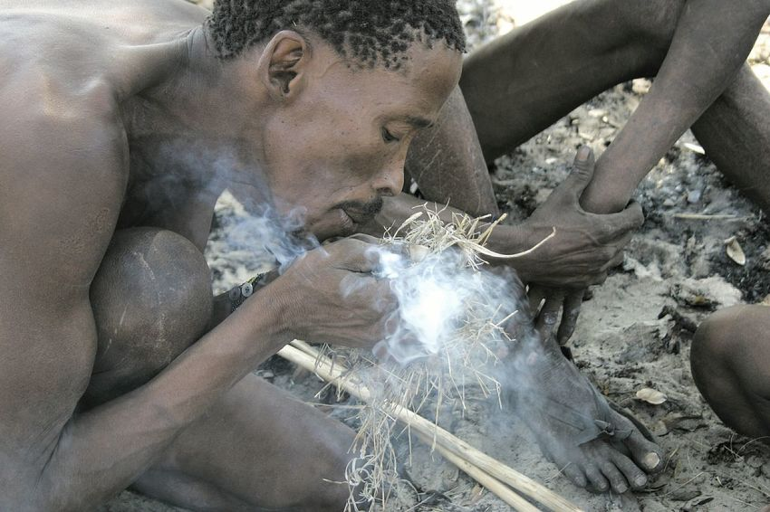Namibian San tribesmen starting a fire using traditional methods. San Tribesmen Culture Traditional Fire Africa Dry Namibia Namibian Bushmen Tsumkwe