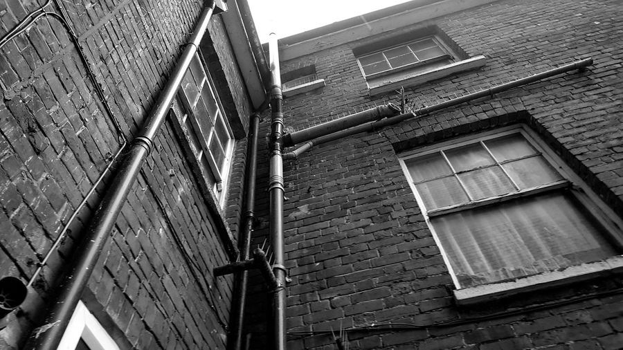 Built Structure Architecture Building Exterior Low Angle View Window Building Sky Day No People Weathered Urban Geometry Urban Architecture Derelict & Abandoned Derelict Building Story Blackandwhite Urban Exploration Black And White Architecture Darkness And Light Low Angle View