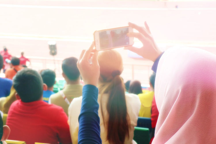 Rear view of people photographing