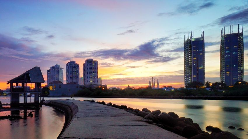 Jgawibowo Skyscraper Urban Skyline Cityscape Reflection Sunset Downtown District Architecture Illuminated Scenics Landscape INDONESIA Photography By Jgawibowo Arif Wibowo Photooftheday Photography Likeforfollow Dramatic Sky Landscape_lovers Low Tide
