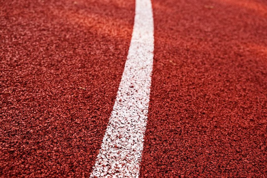 The Devil's In The Detail Sports Track Competitive Sport Competition Sport Sports Race Running Track Playing Field Backgrounds Sprinting Red Dividing Line Single Line