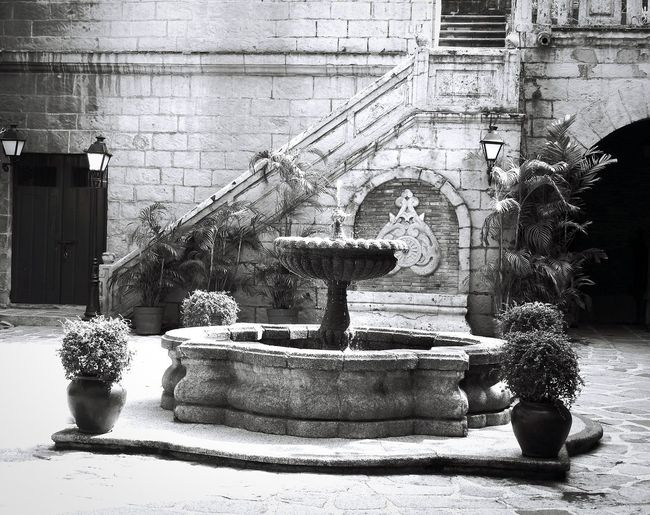 Font Of Serenity ~ Architecture Manila, Philippines Tranquility Fountain Courtyard View Cobblestone Moorish Architecture Intramuros Walled City San Augustin Museum Spanish Arquitecture Meditation Garden Focus On Foreground The Week On EyeEm Blackandwhite Black And White Photography Enclosed Space Stone Staircase Rock Carvings