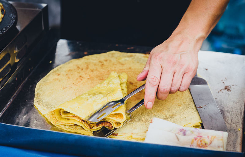 Close-up of person preparing food at kitchen